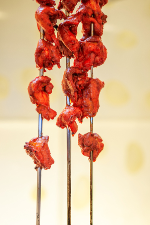 Delicious Beautiful red spicy grilled Indian chicken tandoori skewer