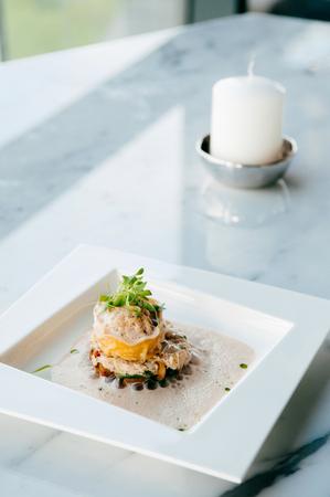 Spinach and ricotta stuffed vegetarion Tortellini Ravioli with white truffle cream sauce 写真素材