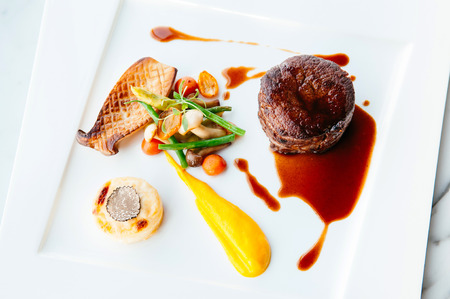 Fillet mignon steak in nice white plate with fine dining style dish decoration