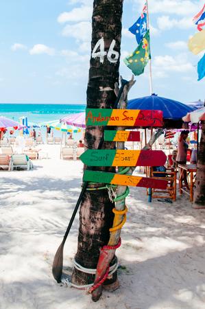 FEB 9, 2013 Phuket, Thailand - Phuket colourful beach sign at Patong beach, summer tropical island white sand beach with sign and coconut tree, Thailand 報道画像