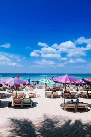 FEB 10, 2013 Phuket, THAILAND - Phuket famous Patong beach with colourful umbrellas, summer tropical island white sand and turqouise water 報道画像
