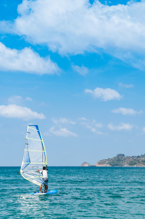 FEB 10, 2013 Phuket, THAILAND - Phuket Patong beach windsurfing sport in hot summer sun, tropical island  turqouise water activity 報道画像