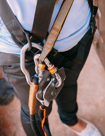Close up shot of climbing gear harness, strap, carabine adventure sport equipment