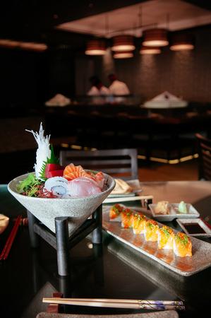 FEB 8, 2013 Phuket, Thailand - Japanese fresh Sushi Sashimi set with various fish and seafood, beautiful dish decoration