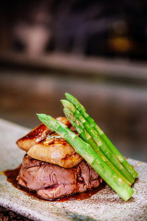 Fillet mignon steak with Foie Gras and spring asparagus Japanese Teppanyaki dining style