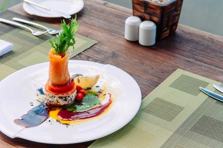 Smoked salmon salad with balsamic and pesto salad dressing, beautiful fine dining dish decoration