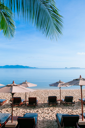 Vacation Relaxation beach beds under umbrella in summer, Samui island bright sunlight and blue sea