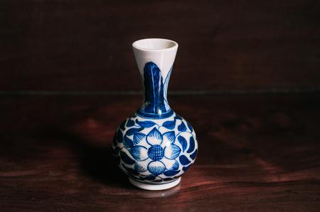 Colourful blue vintage flower painted vase China ware, Chinese porcelain on wooden background Banco de Imagens
