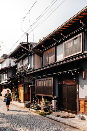 MAY 26, 2013 Gifu, JAPAN - Old houses and Japanese tourist on street of Hida Furukawa town old historic town.
