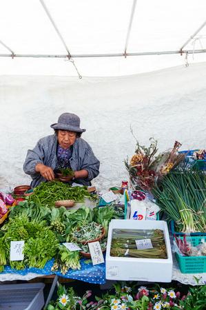 MAY 27, 2013 Takayama ,Gifu, Japan - Local farmer vegetable shop at Sanmachi Suji old Edo district of Takayama, famous shopping and street food district of Takayama old town.