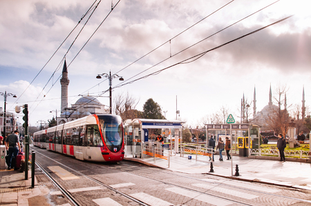 JAN 4, 2018, ISTANBUL, TURKEY : Tram at Sultan Ahmet Blue mosque bus stop, public transportation of Istanbul city with tourists