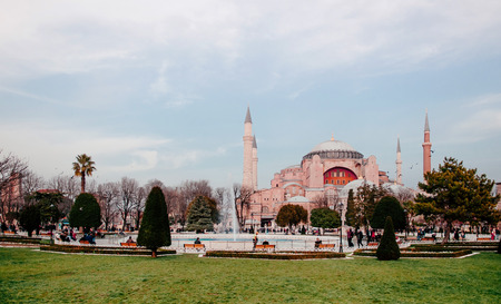 JAN 4, 2018 Istanbul, TURKEY : Hagia Sophia historic mosque in the evening shot from park with tourists and local peoples