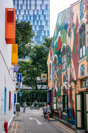 DEC 18, 2013 Singapore - Colourful graffiti art painted wall of colonial building at Haji Lane in Kampong glam district, famous dining and night life area