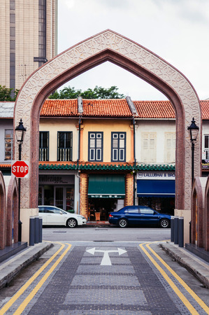 DEC 18, 2013 Singapore  - Arch gate of Masjid Sultan or Sultan mosque with colourful colonial building in Kampong Glam historic area, Rochor district north bridge street