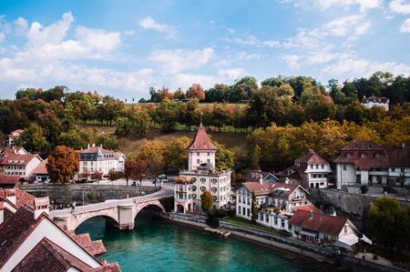 Felsenburg castle tower and Untertorbrucke (Utertor) bridge over turquoise Aare river, Old town Bern - Switzerland