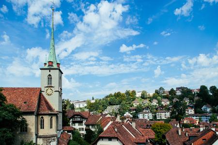Nydeggkirche 14th century Protestant church with bronze reliefs and clock tower next to Untertorbrucke bridge old town Bern - Switzerland 版權商用圖片