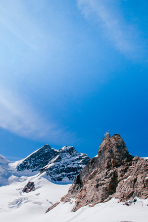 Panoramic view of Sphinx Observation deck tower on Jungfrau top of Europe, snow mountain peak of Switzerland