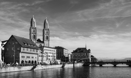 SEP 22, 2013 Zurich, Switzerland - Beautiful old vintage buildings of Grossmunster cathedral and medieval buildings by the Limmat river in Zurich Old town Altstadt area