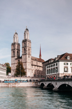 Beautiful old vintage buildings of Grossmunster cathedral and Munsterbrucke over Limmat river in Zurich Old town Altstadt area