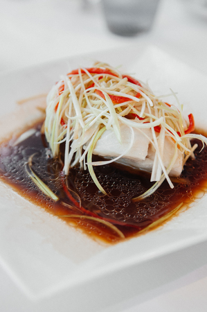 Chinese style steamed Snapper filet fish with sesame oil soy sauce and spring onion, ginger, chili.