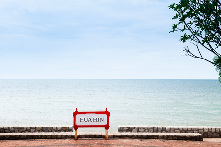 Hua Hin city name sign at beach side on summer sunny day with cloudy sky and calm sea 스톡 콘텐츠 - 120123715