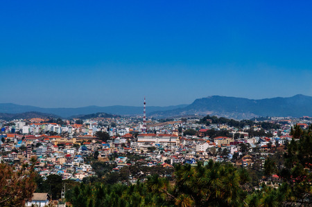 Buildings in Dalat city center located on Langbian Plateau in the southern parts of the Central Highlands region of Vietnam. Banco de Imagens