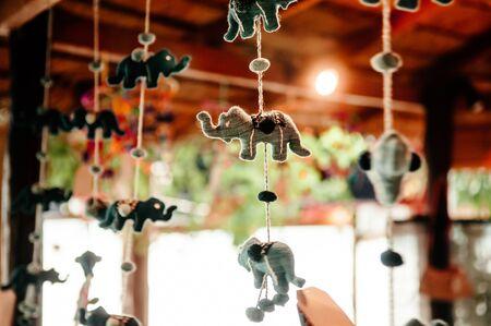 Cute beautiful handmade Fabric Elephant dolls hanging mobile with blurry background Standard-Bild