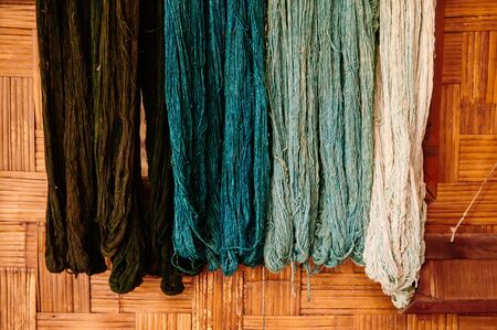 Details of natural colourful cotton thread fiber with natural colour dye process. Traditional sericulture Thai fabric making in Countryside