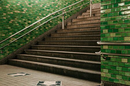 Tokyo subway stairway to station underground passage with retro green tiles wall Фото со стока