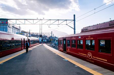 Otsuki, Japan - NOV 30, 2018 : Japanese passenger at quiet Otsuki station platform under warm sunlight. Interchange station between JR and Fujikyu - Fuji Tozan Densha line. Редакционное