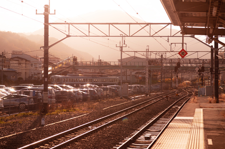 Otsuki, Japan - NOV 30, 2018 : Empty Japan Otsuki train station platform warm sunlight in winter. Interchange station between JR and Fujikyu - Fuji Tozan Densha line. Редакционное