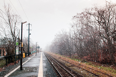 DEC 1, 2018 Hakodate, JAPAN - JR Onuma Koen station empty platform during snow fall in winter foggy atmosphere and beautiful nature scene