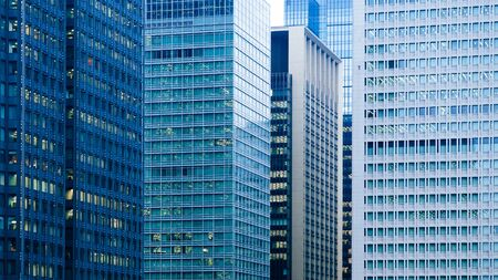 Marunouchi District modern office buildings Tokyo downtown cityscape in evening with offices light on. Japan 写真素材