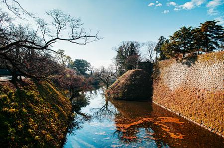 DEC 4, 2018 Aizu Wakamatsu, JAPAN - Aizu Wakamatsu Tsuruga Castle fortess canal and high stone wall. Fukushima Samurai lord fortess in Edo period
