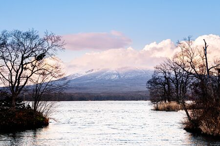 Onuma Koen Quasi -National park lake and Mount Komagatake view in peaceful cold winter. Hakodate, Hokkaido - Japan.