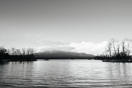 Onuma Koen Quasi -National park lake and Mount Komagatake view in peaceful cold winter. Hakodate, Hokkaido - Japan. Black and white image