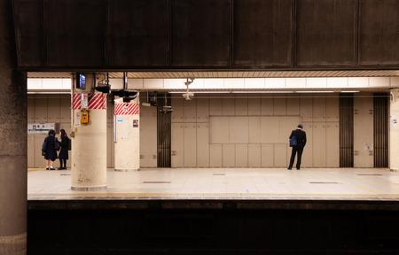 DEC 6, 2019 Tokyo, Japan - Tokyo station underground platform with few passengers waiting for train approaching