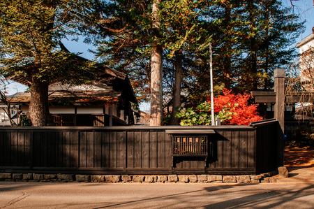 DEC 3, 2018 - Kakunodate, Japan - Kakunodate old Samurai town famous vintage Edo village house fence with pine tree. Akita, Tohoku region 報道画像
