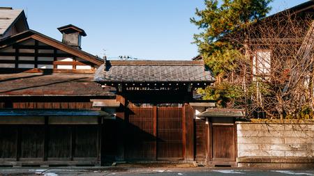 DEC 3, 2018 - Kakunodate, Japan - Kakunodate old Samurai town famous vintage Edo village house gate with pine tree. Akita, Tohoku region