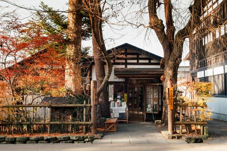 DEC 3, 2018 - Kakunodate, Japan - Kakunodate old Samurai town famous vintage Edo houses that became shop and museum with big tree in Akita, Tohoku region