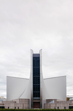 DEC 5, 2019 - Tokyo, JAPAN - Tokyo St. Mary Cathedral Church modern architecture and metal roof with beautiful slope under cloudy sky. Designed by Kenzo Tange and was built in 1964.