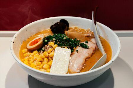 Hokkaido style ramen with sweet corn, butter Chashu pork and soft boiled egg in Tonkotsu miso soup