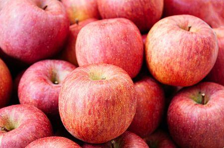 Fresh pinky red Fuji apple, pile of Aomori Ringo in fruit season at farmer market close up.