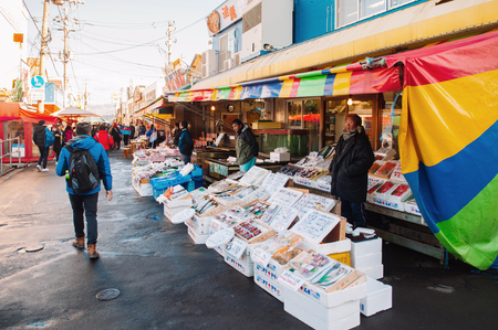 DEC 2, 2018 Hakodate, Japan - Japanese seafood shops with sellers and buyers at Hakodate Asaichi fish market Hokkaido. Famous fresh seafood and street food attaction