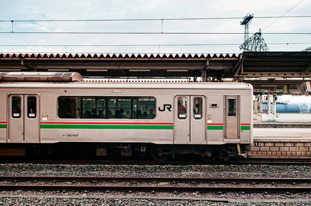 DEC 4, 2018 Koriyama, JAPAN - JR Commuter train stop at Koriyama station with passengers on board seen through windows. Redakční