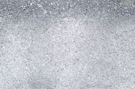 Grey coloured light tone rough grungy textured old concrete wall background wallpaper Reklamní fotografie