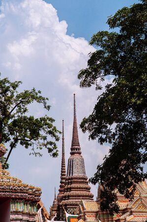 Beautiful pagodas decorated with ceramic tiles at Wat Pho or Wat Phra Chetuphon in Bangkok old town near Grand palace Reklamní fotografie