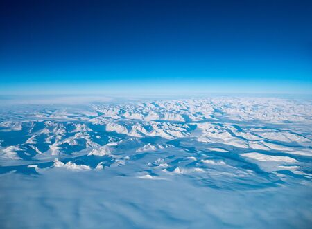 Greenland frozen landscape aerial view shot from plane. Complex Snow Mountains Stunning valley and glacier