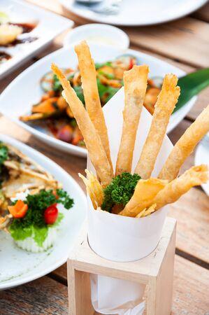 Crispy crunchy golden deep fried cheese stick on lunch table close up deatil Foto de archivo