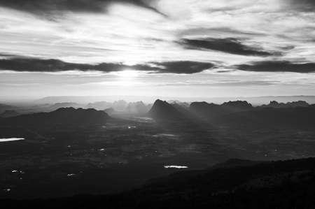Beautiful charming Asian limestone mountain landscape black and white at Pha Nok An cliff. Phu Kradueng National park peaceful morning. Loei - Thailand.